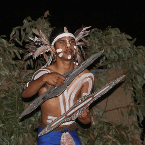 Indigenous Australian man with carvings